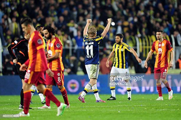 Fenerbahce's Dirk Kuyt celebrates on March 8 2015 after a Turkish Sport Toto Super League football match Fenerbahce vs Galatasaray at the Fenerbahce...