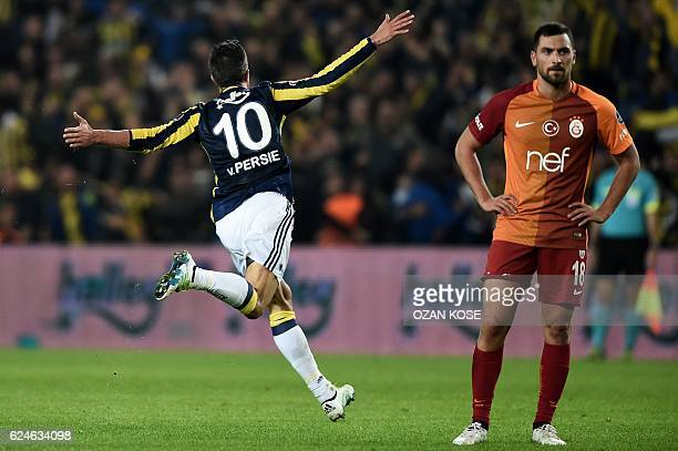 Fenerbahce's Dutch forward Robin Van Persie celebrates after scoring a goal during the Turkish Spor Toto Super Lig football match between Fenerbahce...