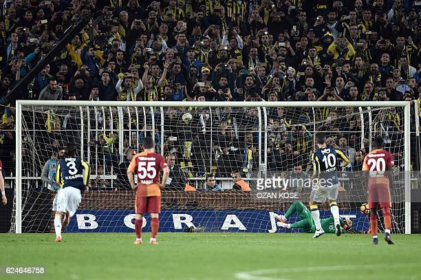 Fenerbahce`s Dutch forward Robin Van Persie scores a goal during the Turkish Super Lig football match between Fenerbahce and Galatasaray at the...
