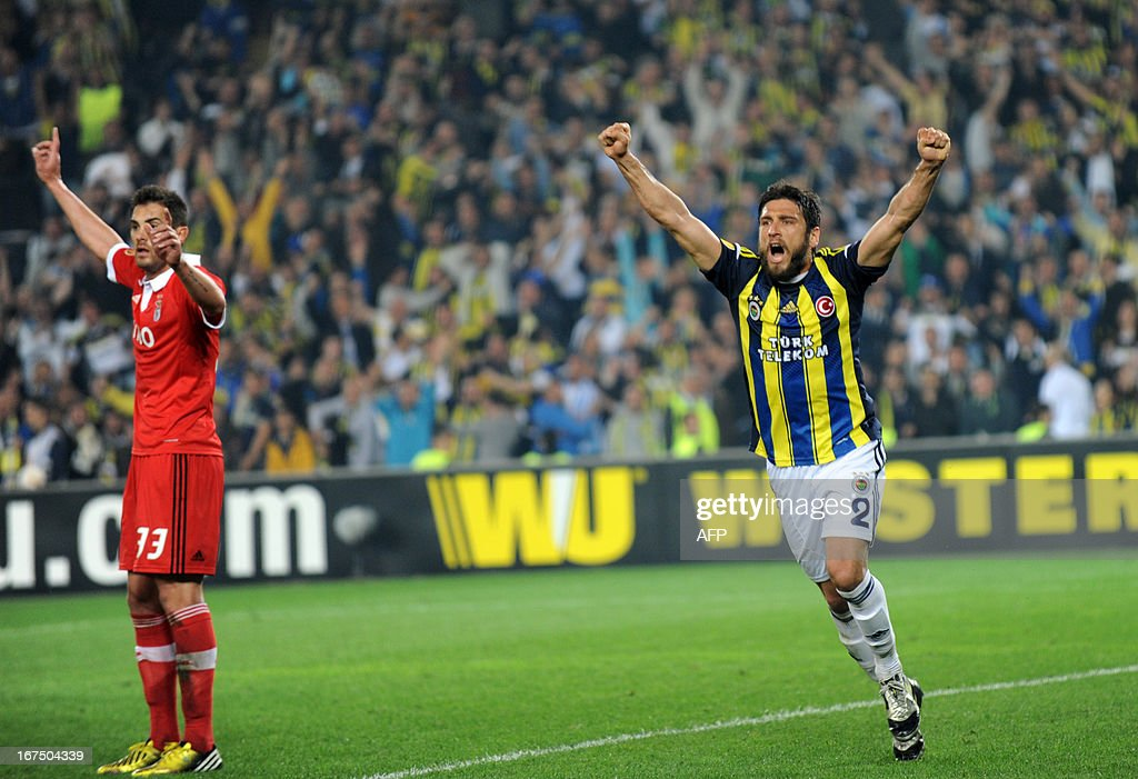 Fenerbahce's Egemen Korkmaz (R) celebrates after scoring during an UEFA Europa League semi-final football match between Fenerbahce and Benfica at Sukru Saracoglu stadium on April 25, 2013 in Istanbul.