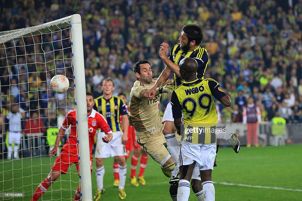 Fenerbahce's Egemen Korkmaz (2ndR) heads and scores during an UEFA Europa League semi-final football match between Fenerbahce and Benfica at Sukru Saracoglu stadium on April 25, 2013 in Istanbul.