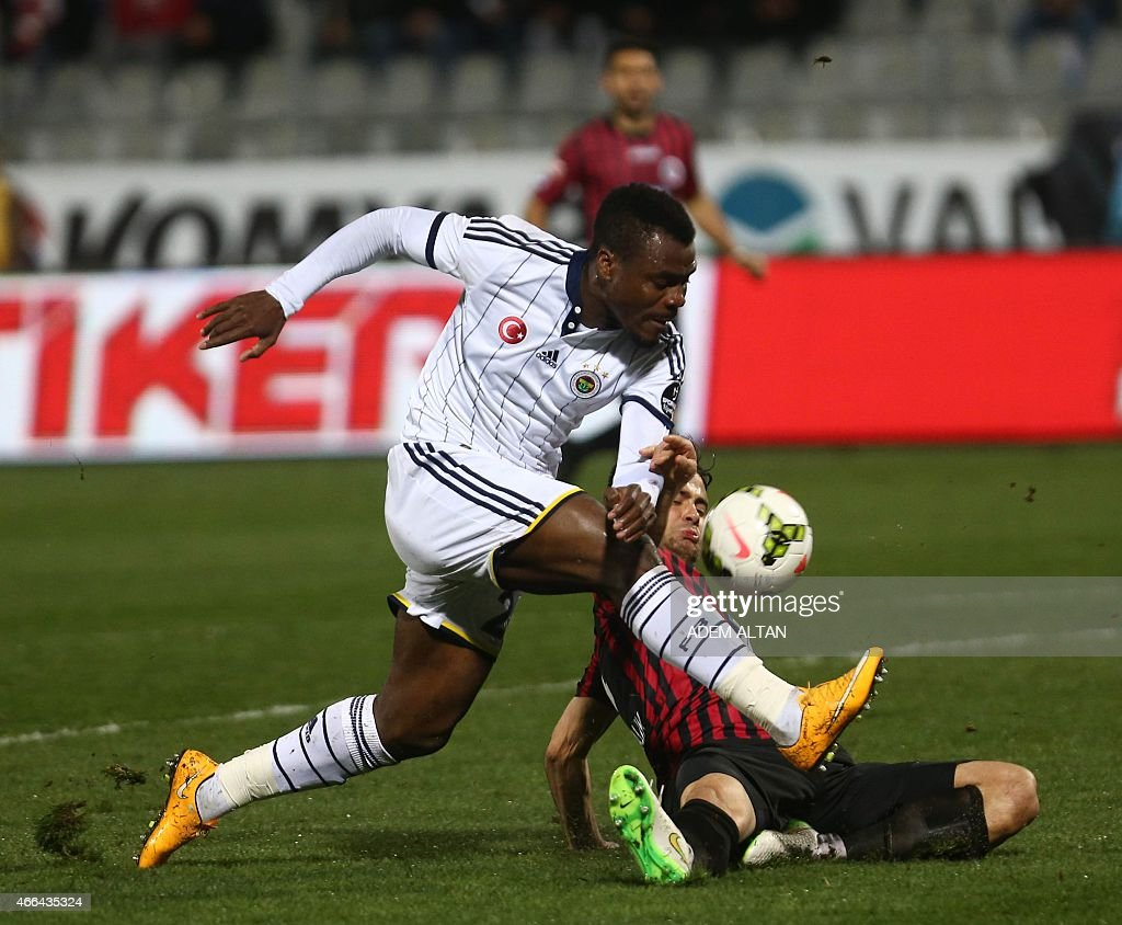 Fenerbahce s Emmanuel Emenike front is tackled during Turkish