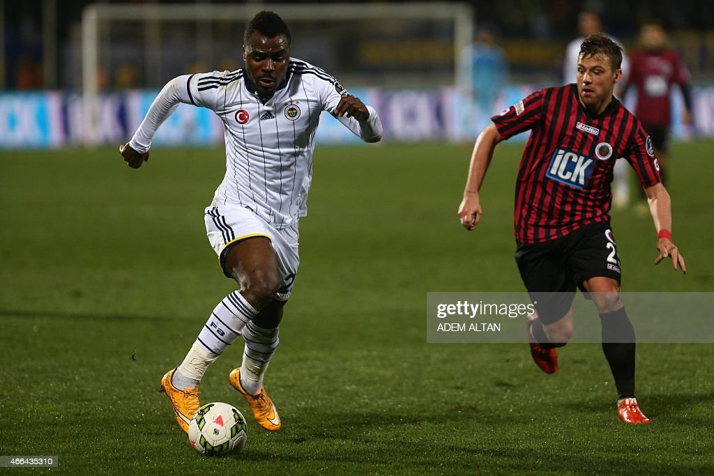 Fenerbahce's <a gi-track='captionPersonalityLinkClicked' href=/galleries/search?phrase=Emmanuel+Emenike&family=editorial&specificpeople=7487637 ng-click='$event.stopPropagation()'>Emmanuel Emenike</a> (L) runs with the ball during Turkish Spor Toto Super League football match between Fenerbahce and Genclerbirligi at 19 May Stadium in Ankara, on March 15, 2015.