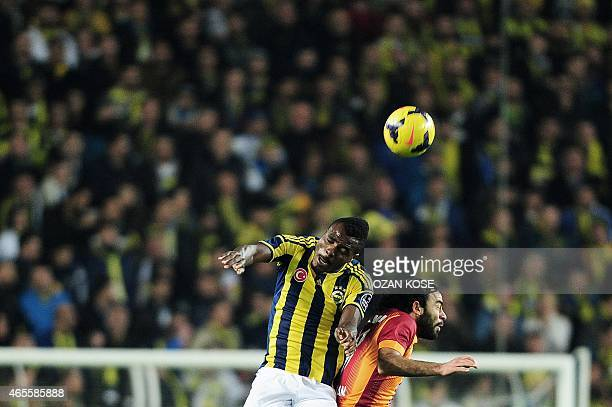 Fenerbahce's Emmanuel Eminike heads the ball next to Galatasaray's Selcuk Inan during the Turkish Super Toto LeagueTurkish Sport Toto Super League...