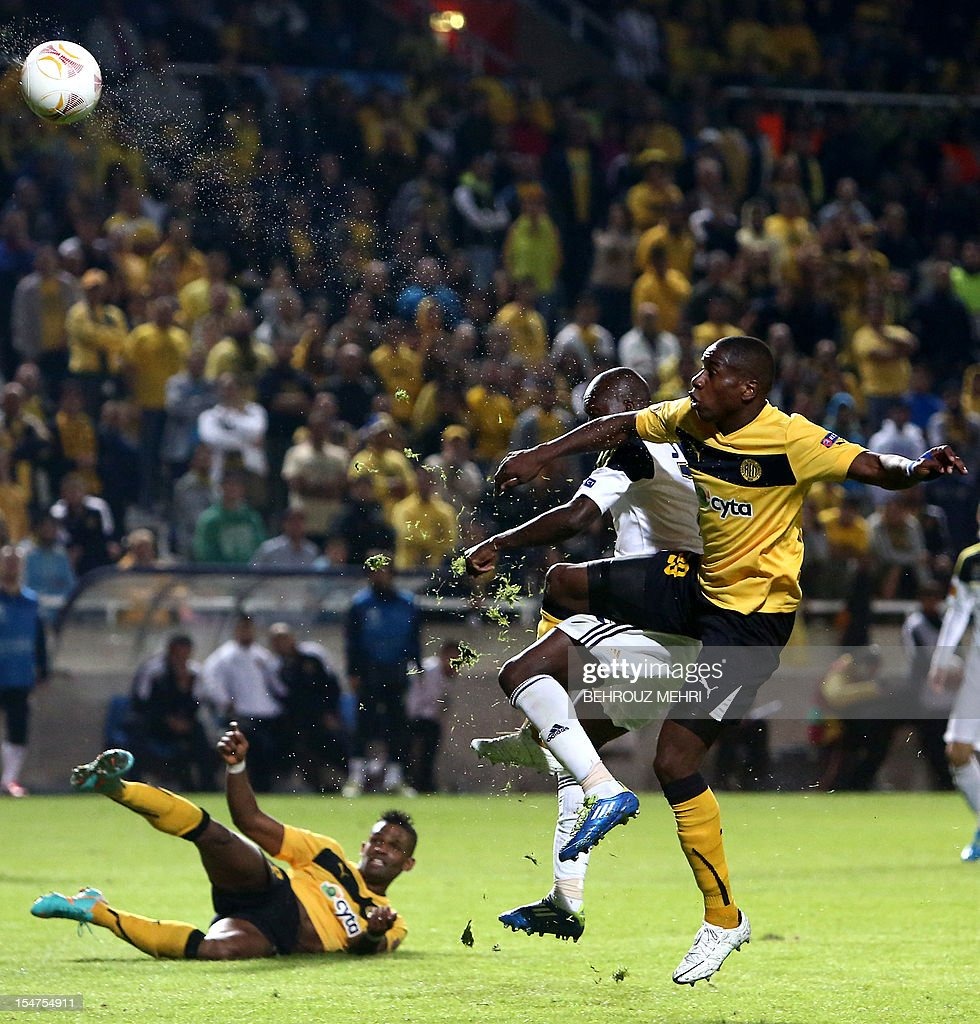 Fenerbahce's forward Moussa Sow (back) challenges AEL Limassol's defender Edwin Ouon during their UEFA Europa League group C football match at GSP Stadium in the Cypriot capital Nicosia on October 25, 2012. Fenerbahce won 1-0.