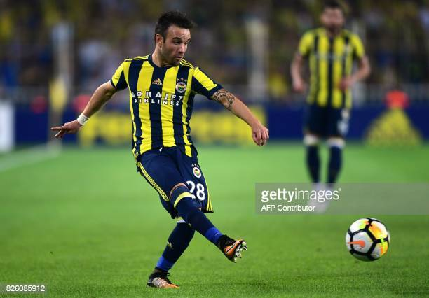 Fenerbahce's french midfielder Mathieu Valbuena passes the ball during the UEFA Europa League third qualifying round second match between Fenerbahce...