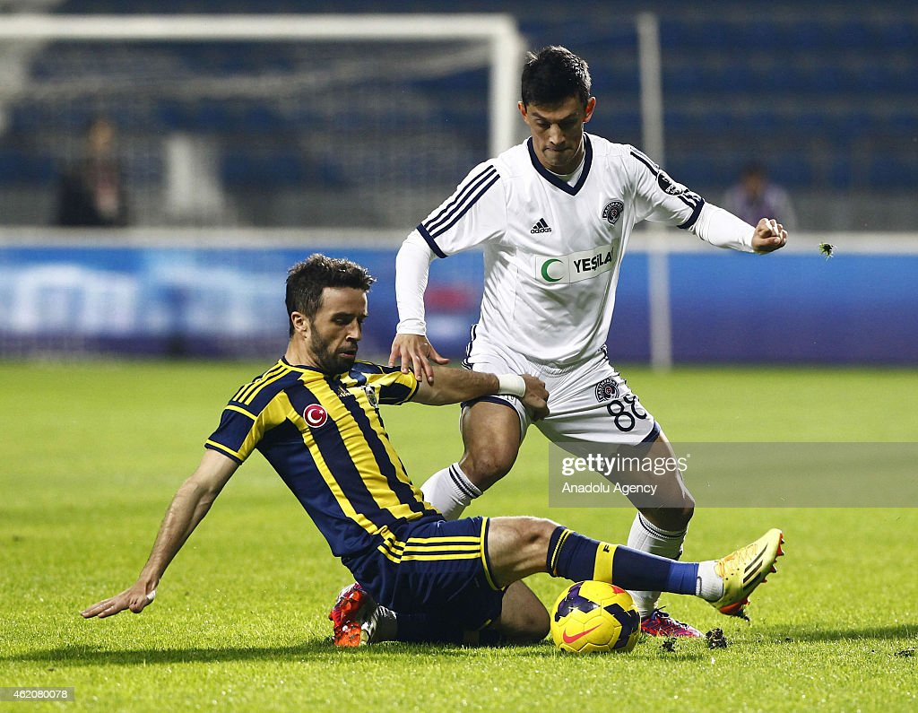 Fenerbahce's Gokhan Gonul (L) vies for ball with Kasimpasa's Andre Castro Pereira (R) during the Turkish Spor Toto Super League soccer match between Kasimpasa and Fenerbahce at Recep Tayyip Erdogan Stadium in Istanbul, Turkey on January 24, 2015.