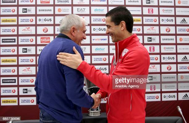 Fenerbahce's Head coach Zeljko Obradovic and Coach Ioannis Sfairopoulos of Olympiacos shake hands in front of the Turkish Airlines EuroLeague...