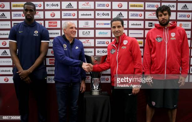 Fenerbahce's Head coach Zeljko Obradovic with Ekpe Udoh and Coach Ioannis Sfairopoulos of Olympiacos with Georgios Printezis pose with the Turkish...