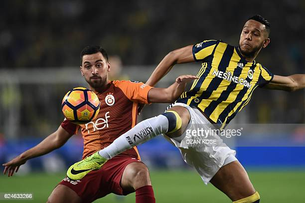 Fenerbahce's Josef de Souza vies with Galatasaray's Sinan Gumus during the Turkish Spor Toto Super Lig football match between Fenerbahce and...