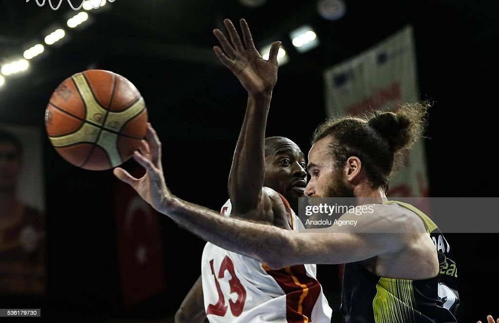 Fenerbahce's Luigi Datome (R) and Galatasaray Odeabank's Stephane Lasme in action during the Turkish Spor Toto Basketball League play-offs semi-final match between Galatasaray Odeabank and Fenerbahce at Abdi Ipekci Sports Hall in Istanbul, Turkey on May 31, 2016.