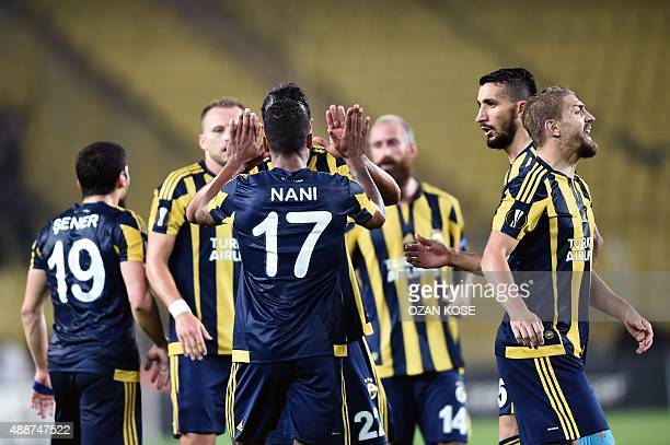 Fenerbahce's Luis Nani celebrates with teammates after scoring a goal during the Europa League football match between Fenerbahce and Molde on...
