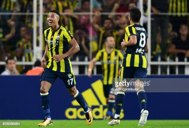 Fenerbahce`s Nabil Dirar celebrates with teammates after scoring a goal during the UEFA Europa League third qualifying round second match between...
