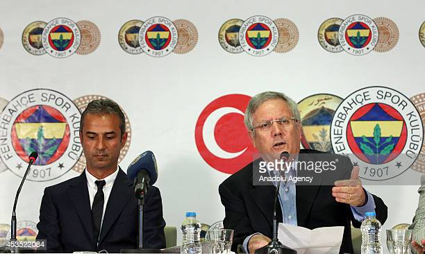 Fenerbahce's new head coach Ismail Kartal attends a signing ceremony with Fenerbahce club chairman Aziz Yildirim in Istanbul Turkey on August 12 2014