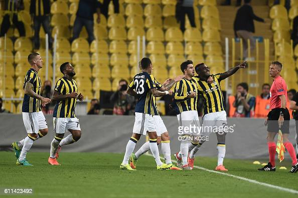 Fenerbahce's Nigerian forward Emmanuel Emenike celebrates with his teammates after scoring a goal during the UEFA Europa League football match...