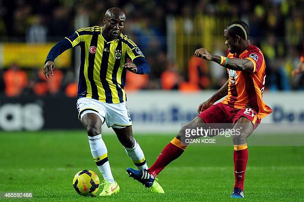 Fenerbahce's Pierre Webo fights for the ball with Galatasaray's Aurelien Chedjou on March 8 2015 after a Turkish Sport Toto Super League football...