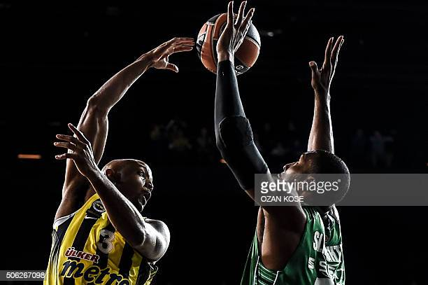 TOPSHOT Fenerbahce's pivot Ricky Hickman vies with Darussafaka's forward Luke Harangody during the Euroleague basketball match between Darussafaka...