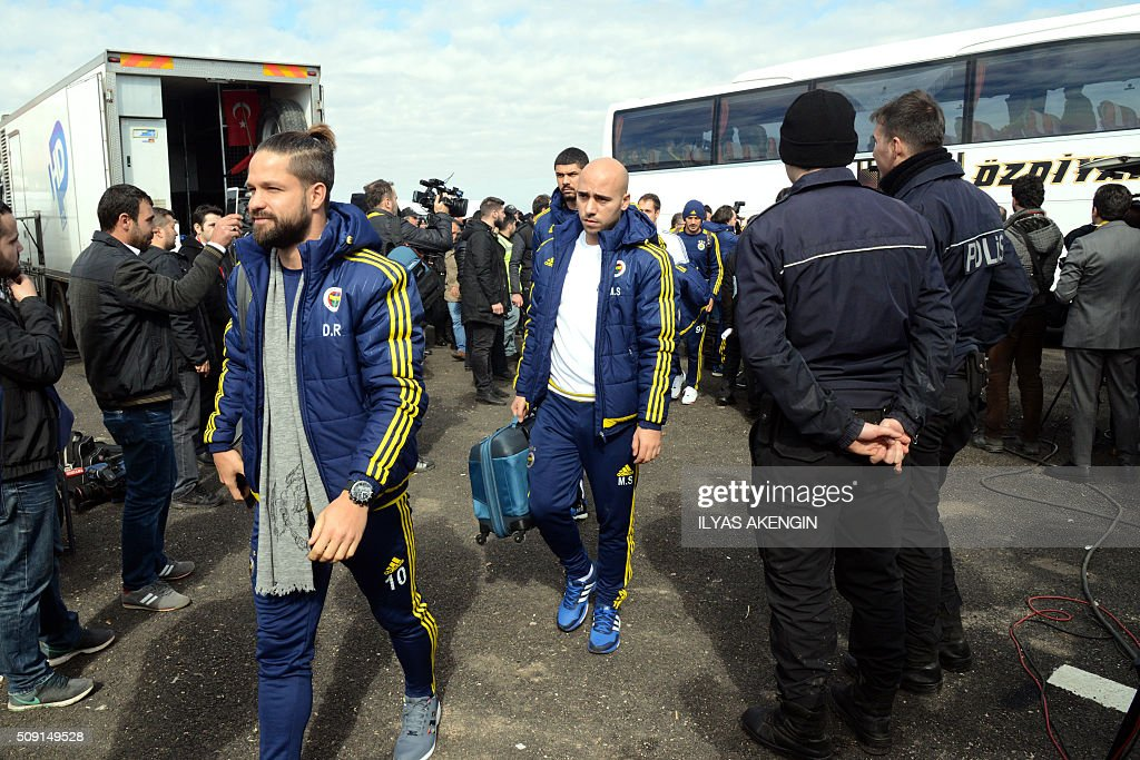 Fenerbahce's players arrive to the stadium prior to the Turkish Cup football match between Amed Spor and Fenerbahce Zirrat on February 9, 2016 in Diyarbakir. The Turkish Football Federation said on February 5, 2016 it had suspended a Kurdish player for statements considered 'ideological propaganda' on the conflict in the Kurdish-majority southeast, adding to a string of cases cracking down on freedom of expression in Turkey. AKENGIN
