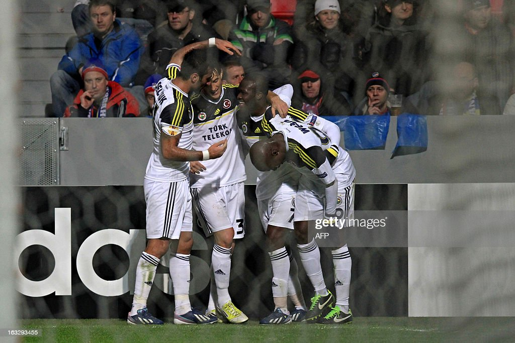 Fenerbahce's players celebrate a goal during the UEFA Europa League Round of 16 first leg football match FC Viktoria Plzen vs Fenerbahce SK in Plzen, Czech Republic, on March 7, 2013.