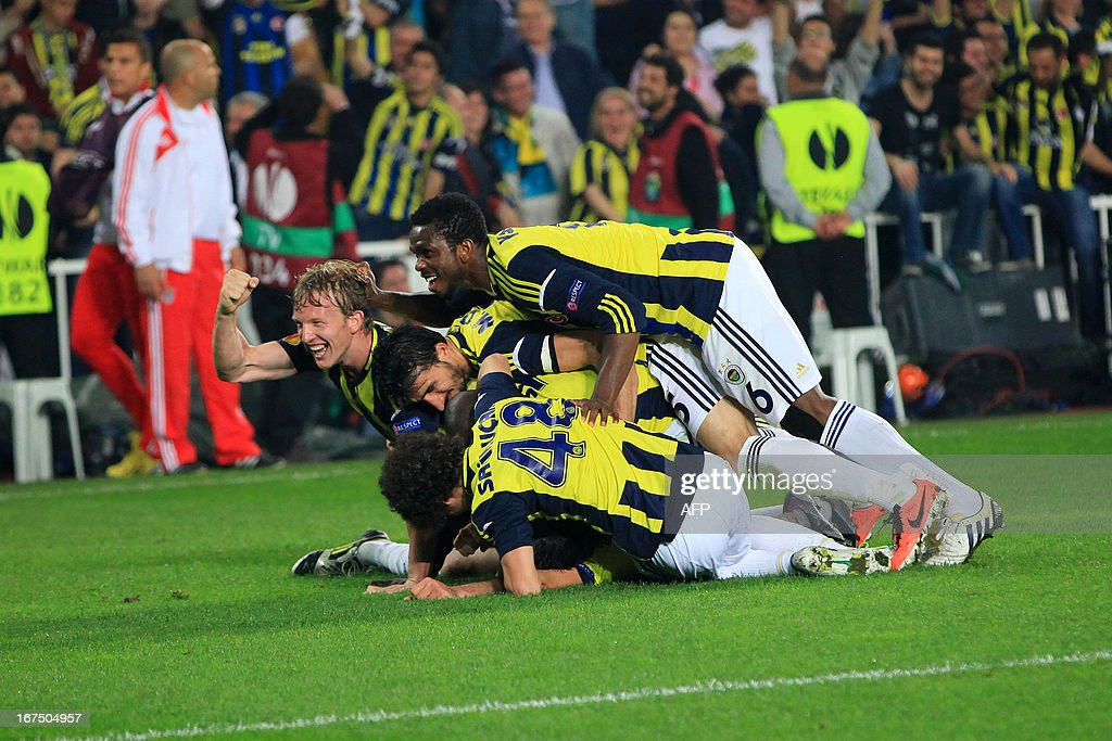 Fenerbahce's players celebrate after scoring during an UEFA Europa League semi-final football match between Fenerbahce and Benfica at Sukru Saracoglu stadium on April 25, 2013 in Istanbul.