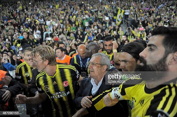Fenerbahce's players celebrate their 20132014 champion title with Fenerbahce's President Aziz Yildirim after the Turkish Super league football match...