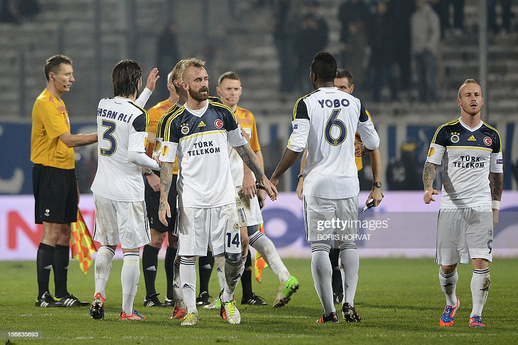 Fenerbahce's players leave the pitch after the UEFA Europa League Group C3 football match between Olympique de Marseille and Fenerbahce SK, on November 22, 2012, at the velodrome stadium in Marseille.