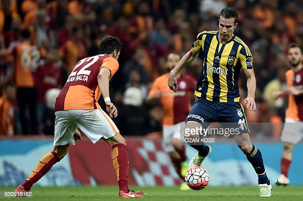 Fenerbahce`s Robin Van Persie vies for the ball with Galatasaray`s Hakan Balta during the Turkish Spor Toto Super league football match between...