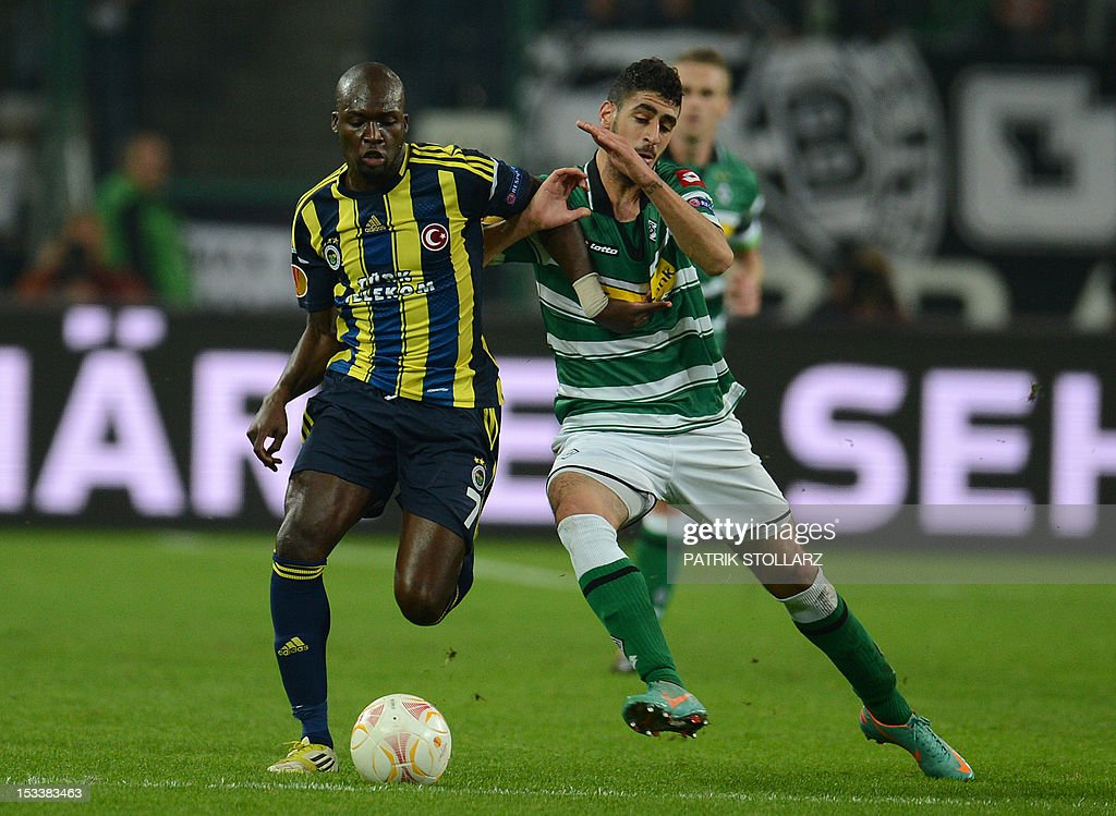 Fenerbahce´s Senegalese striker Moussa Sow and Moenchengladbach's midfielder Tolga Cigerci (R) during the UEFA Europa League Group C football match Borussia Moenchengladbach vs Fenerbahce SK in the western German city of Moenchengladbach on October 4, 2012.