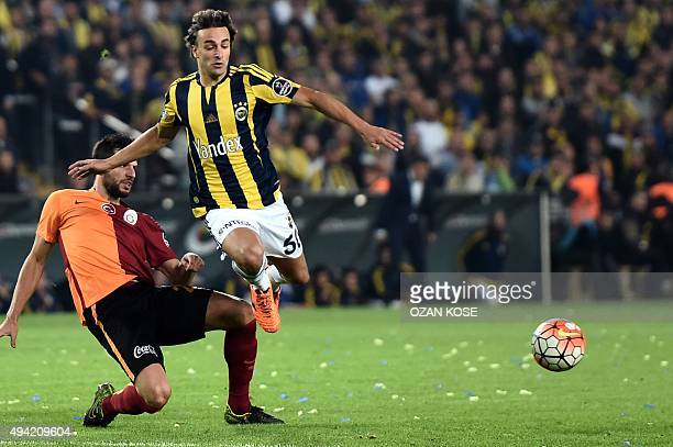 Fenerbahce's Serbian forward Lazar Markovic vies for the ball with Galatasaray's Turkish defender Hakan Balta during the Turkish Super Lig football...