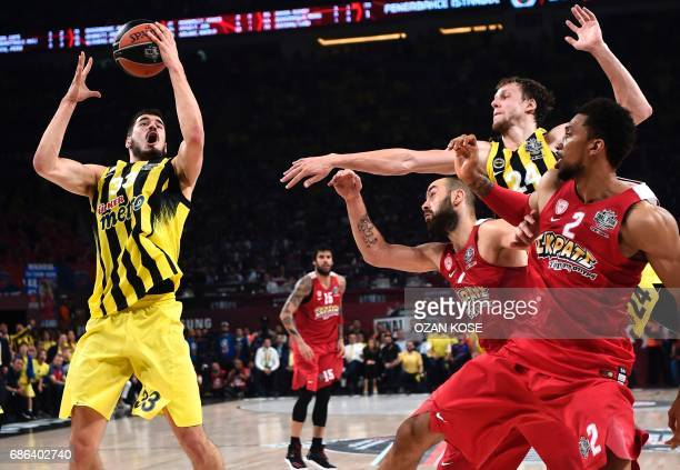 Fenerbahce's Serbian forward Nikola Kalinic vies with Olympiacos Piraeus' Canadian center Khem Birch and Greek guard Vassilis Spanoulis during the...