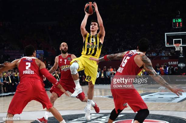 Fenerbahce's Serbian guard Bogdan Bogdanovic vies with Olympiacos Piraeus' Canadian center Khem Birch Greek guard Vassilis Spanoulis and Greek...