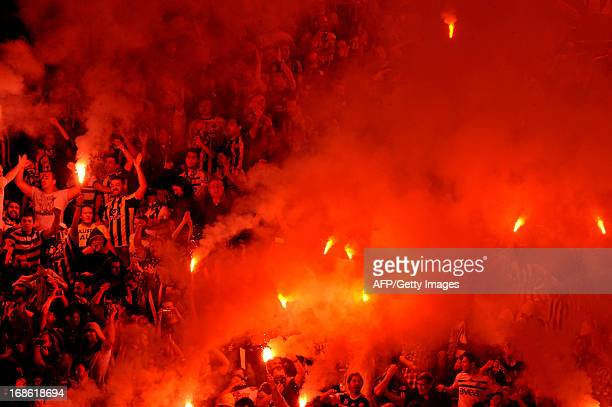 Fenerbahce's supporters celebrate their team's victory at the end of the Turkish Super League football match between Fenerbahce and Galatasaray at...