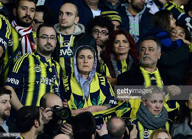 Fenerbahce's supporters cheer the team during the Turkish Spor Toto Super League soccer match between Fenerbahce and Kasimpasa at Sukru Saracoglu...