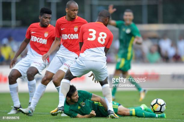 Fenerbahce's Turkish midfielder Ahmethan Kose falls next to Monaco's Brazilian defender Jemerson Monaco's Brazilian defender Fabinho and Monaco's...