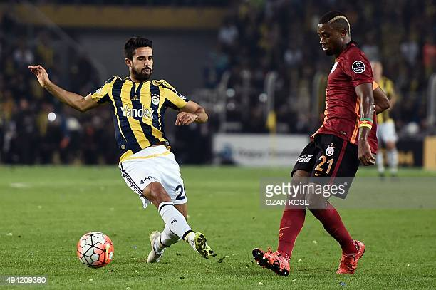 Fenerbahce's Turkish midfielder Alper Potuk vies for the ball with Cameroonian defender Galatasara's Aurelien Chedjou during the Turkish Super Lig...