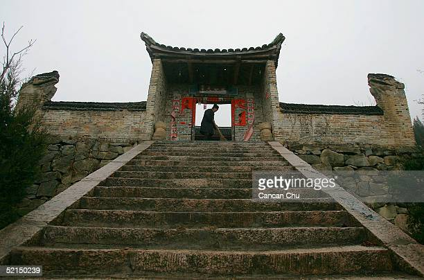 Feng a 72year old Taoist monk sweeps the floor at 'Tian Xin Guan' temple on February 6 2005 in the countryside of Jinzhai County Anhui Province China...