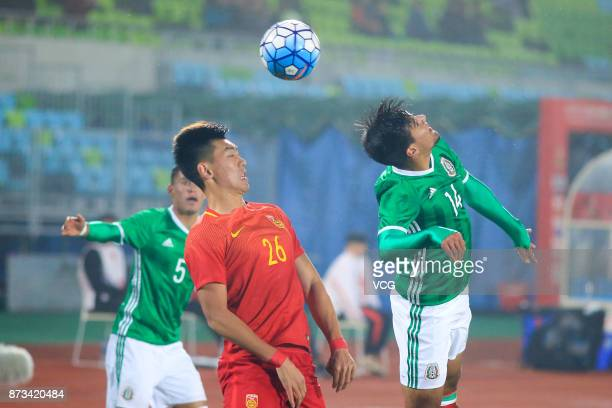 Feng Boyuan of China and Reynoso Avila Hector of Mexico vie for the ball during the CFA International Youth Football Tournament Duyun 2017 between...