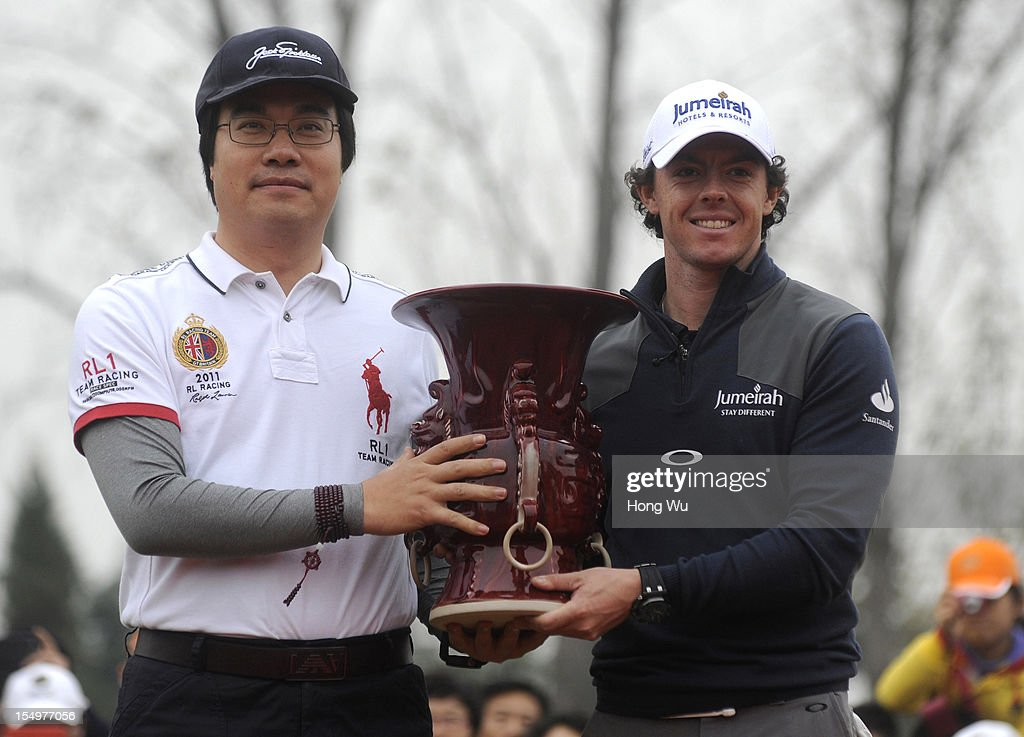 Feng Changge, Chairman Harmony Group (L) and <a gi-track='captionPersonalityLinkClicked' href=/galleries/search?phrase=Rory+McIlroy&family=editorial&specificpeople=783109 ng-click='$event.stopPropagation()'>Rory McIlroy</a> of Northern Ireland hold trophy at the award ceremony during the Duel of <a gi-track='captionPersonalityLinkClicked' href=/galleries/search?phrase=Tiger+Woods&family=editorial&specificpeople=157537 ng-click='$event.stopPropagation()'>Tiger Woods</a> and <a gi-track='captionPersonalityLinkClicked' href=/galleries/search?phrase=Rory+McIlroy&family=editorial&specificpeople=783109 ng-click='$event.stopPropagation()'>Rory McIlroy</a> at Jinsha Lake Golf Club on October 29, 2012 in Zhengzhou, China.