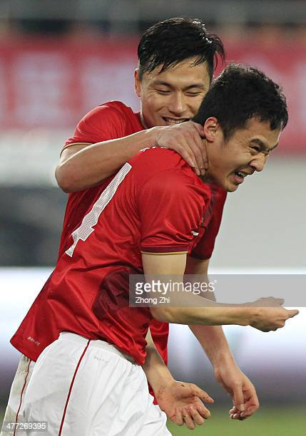 Feng Renliang of Guangzhou Evergrande celebrates scoring their second goal with teammate Gao Lin during the China Super League match between...