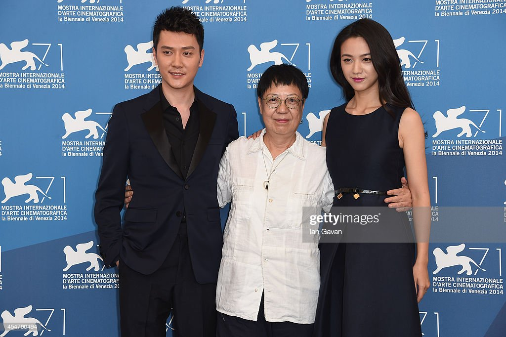 <a gi-track='captionPersonalityLinkClicked' href=/galleries/search?phrase=Feng+Shaofeng&family=editorial&specificpeople=7926179 ng-click='$event.stopPropagation()'>Feng Shaofeng</a>, director <a gi-track='captionPersonalityLinkClicked' href=/galleries/search?phrase=Ann+Hui&family=editorial&specificpeople=2554073 ng-click='$event.stopPropagation()'>Ann Hui</a> and actress <a gi-track='captionPersonalityLinkClicked' href=/galleries/search?phrase=Tang+Wei&family=editorial&specificpeople=4329520 ng-click='$event.stopPropagation()'>Tang Wei</a> attend 'The Golden Era' (Huangjin Shidai) photocall during the 71st Venice Film Festival at the Palazzo del Casino on September 6, 2014 in Venice, Italy.