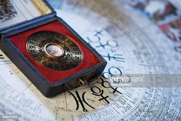 Feng shui compass over a Chinese calendar