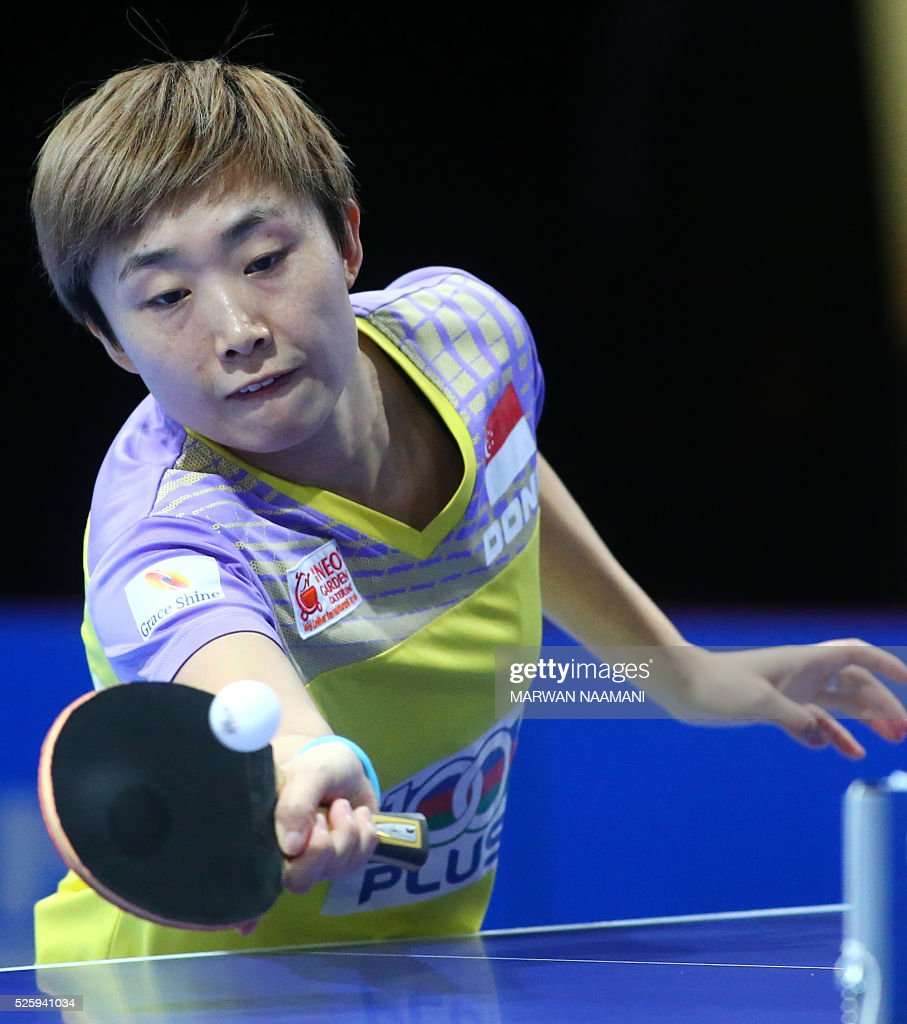 Feng Tianwei of Singapore returns the ball to Hirano Miu of Japan during their women's singles quarter final table tennis match in the ITTF Nakheel Table Tennis Asian Cup, on April 29, 2016 in Dubai. / AFP / MARWAN