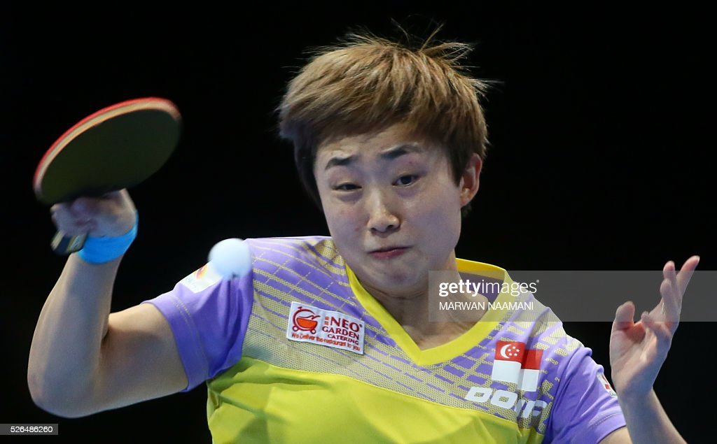 Feng Tianwei of Singapore returns the ball to Tie Yana of Hong Kong during their women's singles third-fourth place table tennis match in the ITTF Nakheel Table Tennis Asian Cup, on April 30, 2016 in Dubai. NAAMANI