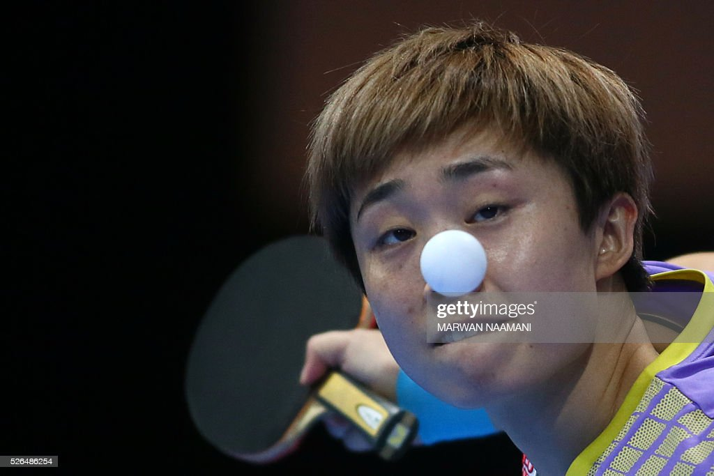 Feng Tianwei of Singapore serves the ball to Tie Yana of Hong Kong during their women's singles third-fourth place table tennis match in the ITTF Nakheel Table Tennis Asian Cup, on April 30, 2016 in Dubai. NAAMANI