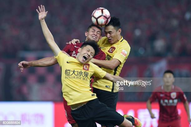 Feng Xiaoting and Zou Zheng of Guangzhou Evergrande and Elkeson of Shanghai SIPG head the ball during the 18th round match of 2017 Chinese Football...