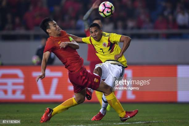 Feng Xiaoting of China in action against Carlos Bacca of Colombia during International Friendly Football Match between China and Colombia at the...