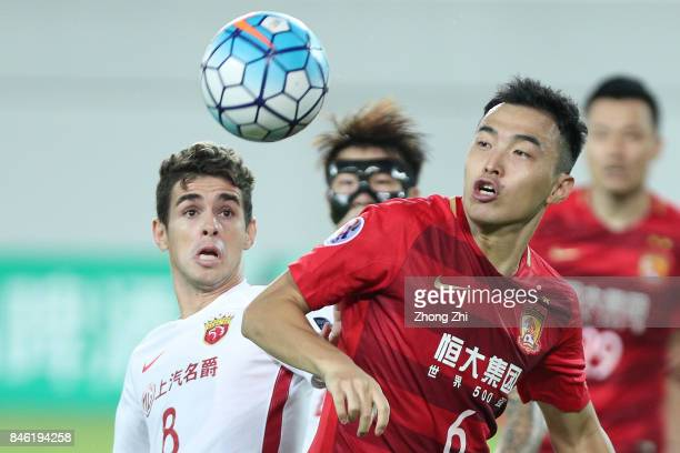 Feng Xiaoting of Guangzhou Evergrande in action against Oscar Emboaba Junior of Shanghai SIPG during the AFC Champions League 2017 Quarterfinals 2nd...