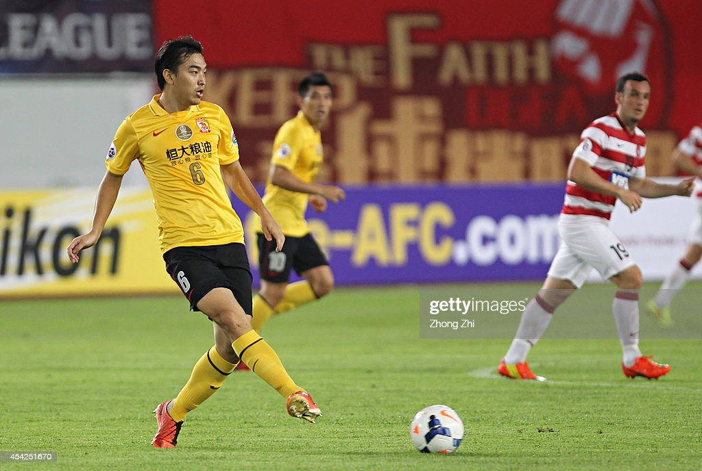 Feng Xiaoting of Guangzhou Evergrande in action during the Asian Champions League Quarter Final match between the Western Sydney Wanderers and Guangzhou Evergrande at Tianhe Sports Center on August 27, 2014 in Guangzhou, China.