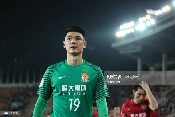 Feng Xiaoting of Guangzhou Evergrande reacts with team mates after the AFC Champions League 2017 Quarterfinals 2nd leg between Shanghai SIPG and...