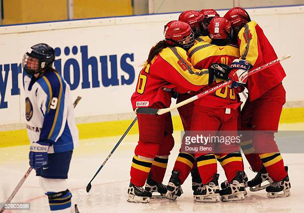 Fengling Jin of team China is congratulated by teammates after scoring their team's third and final goal against Olga Potapova L and team Kazakhstan...